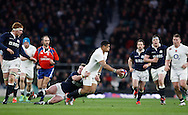 Luther Burrell of England passes while being tackled by Stuart Hogg of Scotland during the RBS 6 Nations match at Twickenham Stadium, Twickenham<br /> Picture by Andrew Tobin/Focus Images Ltd +44 7710 761829<br /> 14/03/2015