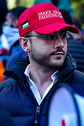 """London, United Kingdom, May 22, 2021: """"Make Israel Palestine Again"""" says a slogan on a red hat of a man attending a pro-Palestinian rally outside the Israeli Embassy Kensington, central London on Saturday, May 22, 2021. Egyptian mediators held talks Saturday to firm up an Israel-Hamas cease-fire as Palestinians in the Hamas-ruled Gaza Strip began to assess the damage from 11 days of intense Israeli bombardment. (Photo by Vudi Xhymshiti/VXP)"""