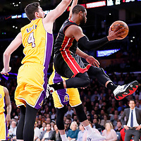 13 January 2014: Miami Heat guard Dwyane Wade (3) passes the ball while in the air past Los Angeles Lakers forward Ryan Kelly (4) and Los Angeles Lakers guard Jeremy Lin (17) during the Miami Heat 78-75 victory over the Los Angeles Lakers, at the Staples Center, Los Angeles, California, USA.