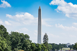 June 18, 2017 - Washington, DC, United States - A view of The Washington Monument, and The Thomas Jefferson Memorial, from the South Lawn of the White House, on Father's Day, Sunday, June 18, 2017. (Photo by Cheriss May) (Credit Image: © Cheriss May/NurPhoto via ZUMA Press)