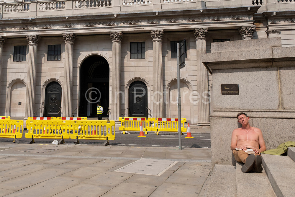As Britain enters a period of deep recession, as the economic downturn caused by the Covid-19 pandemic cuts hard, one man has closes his eyes for some rest near the Bank of England as the economy sleeps at the heart of the financial district on 12th August 2020 in London, United Kingdom. The Office for National Statistics / ONS has announced that gross domestic product / GDP, the widest gauge of economic health, fell by 20.4% in the second quarter of the year, compared with the previous quarter. This is the biggest decline since records began. The result is that Britain has officially entered recession, as the UK economy shrank more than any other major economy during the coronavirus outbreak.