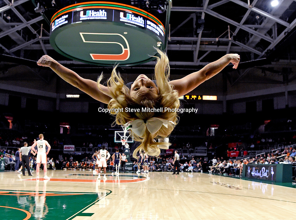 Feb 6, 2019; Coral Gables, FL, USA; Miami Hurricanes cheerleader performs a backflip during the first half against the Notre Dame Fighting Irish at Watsco Center. Mandatory Credit: Steve Mitchell