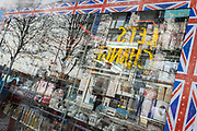 The multi-coloured window of a closed trinket and souvenir business on Oxford Street, during the third lockdown of the Coronavirus pandemic, on 29th March 2021, in London, England.