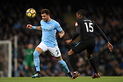 Manchester City's Kyle Walker (left) and West Ham United's Diafra Sakho battle for the ball