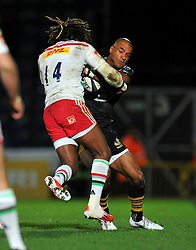 Tom Varndell of Wasps is tackled by Marland Yarde of Harlequins - Photo mandatory by-line: Patrick Khachfe/JMP - Mobile: 07966 386802 26/10/2014 - SPORT - RUGBY UNION - High Wycombe - Adams Park - Wasps v Harlequins - European Rugby Champions Cup- Photo mandatory by-line: Patrick Khachfe/JMP - Mobile: 07966 386802 26/10/2014 - SPORT - RUGBY UNION - High Wycombe - Adams Park - Wasps v Harlequins - European Rugby Champions Cup