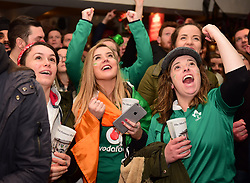 English and Irish fans in the Cabbage Patch pub in Twickenham, London watch the first half of the Six Nations rugby match between Ireland and England.