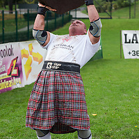 Competitor lifts a stone in the Highland Game competition held at the FitParade mass sports event in Budapest, Hungary on October 17, 2015. ATTILA VOLGYI