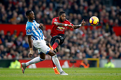 Manchester United's Fred (right) and Huddersfield Town's Isaac Mbenza battle for the ball during the Premier League match at Old Trafford, Manchester.