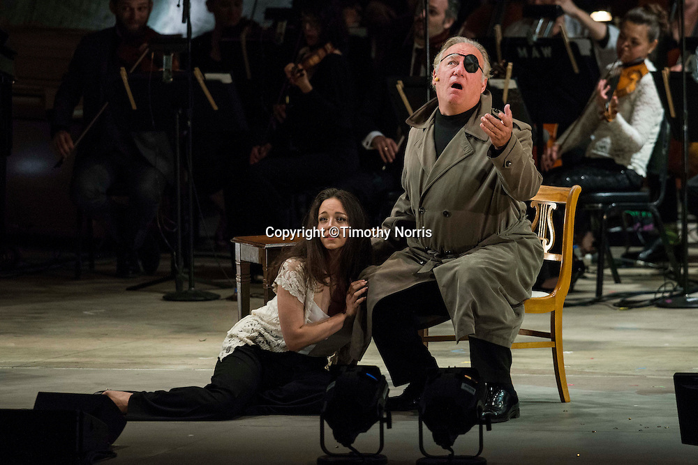 """Peabody Southwell (mezzo-soprano) as """"Subdominant"""" and Kim Josephson (baritone) as """"Tristan Chord"""" in the world premiere of Steven Stucky and Jeremy Denk's The Classical Style: An Opera (of Sorts) at the 68th Ojai Music Festival at Libbey Bowl on June 13, 2014 in Ojai, California."""