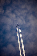 """Airliner with contrails, above the Pyrenees, France.<br /> <br /> Aviation is one of the fastest growing sources of greenhouse gas (GHG) emissions and the most climate-intensive form of transport. Aviation emissions have more than doubled in the last 20 years and the sector is responsible for an estimated 4.9% of man-made global warming - and growing 21% in EU in last three years). While other sectors are working to decarbonise, there's no sign of any viable alternative to fossil fuelled flight anytime soon - electric engines are a long way off. Flying seems, cheap, and it seems easy, but it's actually expensive - and we've yet to pay the cost. In the EU, many tickets are VAT-exempt, costing governments €17 billion annually. If applied, tickets would cost, around 20% or so extra, depending on where you live. Plus, Fuels used in commercial aviation are exempt from excise duties in the EU. (Facts from Transport & Environment website). This mage can be licensed via Millennium Images. Contact me for more details, or email mail@milim.com For prints, contact me, or click """"add to cart"""" to some standard print options."""