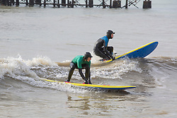 © Licensed to London News Pictures. 04/02/2017. Brighton, UK. Members of the Brighton and Hove Surf Live Saving Club brave the powerful waves to spent some time surfing. Photo credit: Hugo Michiels/LNP
