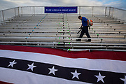 Craig Stewart, an airport employee, cleans bleachers with a leaf blower following Republican presidential candidate Donald Trump's campaign rally at Lakeland Linder Regional Airport in Lakeland, Florida, October 12, 2016.
