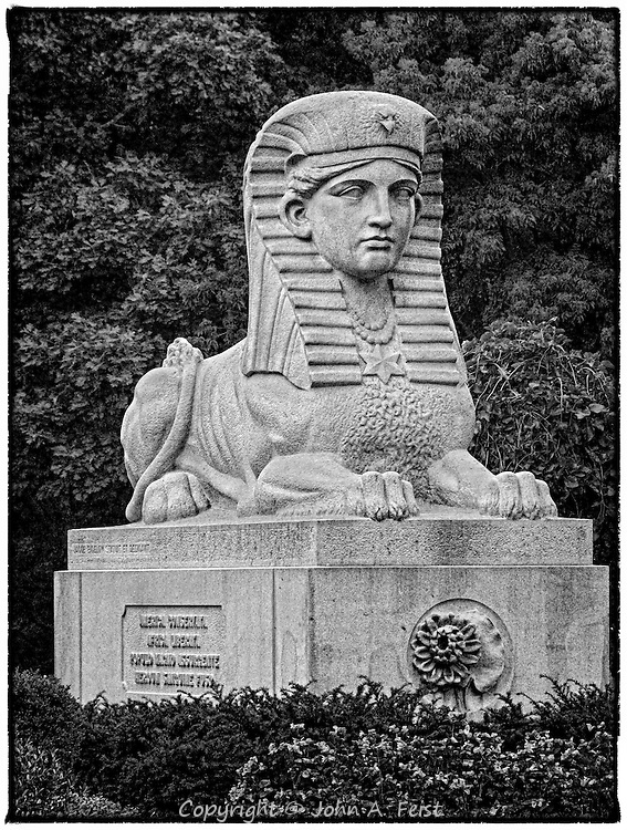 """Outside Bigelow Chapel at Mount Auburn Cemetery in Watertown MA is this sphinx.  At first I viewed it almost as a parody on the Egyptian original.  <br /> <br /> Having done some more research I learned that the chapel is dedicated to all those who fell in the Civil War.  The sphinx is part of that memorial.  The inscription reads <br /> """"American Union Preserved<br /> African Slavery Destroyed<br /> By the Uprising of a Great People<br /> by the Blood of Fallen Heroes""""<br /> It is in English on one side and Latin on the other"""