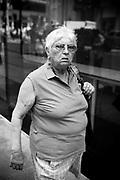 An elderly woman in the street,  Manhattan. New York City, 21 june 2010. Christian Mantuano / OneShot