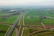 Nederland, Gelderland , Gemeente Geldermalsen, 15-11-2010; omgeving Meteren, spoorlijn Utrecht-Den Bosch kruist Betuweroute en A15..luchtfoto (toeslag), aerial photo (additional fee required).foto/photo Siebe Swart