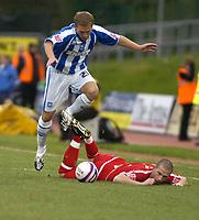 Photo: Matt Bright/Sportsbeat Images.<br /> Brighton & Hove Albion v Carlisle United. Coca Cola League  1. 24/11/2007.<br /> Matt Richards of Brighton skips over a stricken Joe Garner of Carlisle