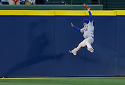 ATLANTA, GA - APRIL 09:  Centerfielder Juan Lagares #12 of the New York Mets makes a catch against the wall during the game against the Atlanta Braves at Turner Field on April 9, 2014 in Atlanta, Georgia.  (Photo by Mike Zarrilli/Getty Images)