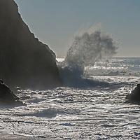 Pacific Ocean waves crash ashore at Gray Whale Cove State Beach near San Francisco, California.
