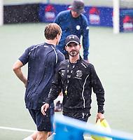 UTRECHT - Kampong coach Alexander Cox  tijdens  de training, in de stromende regen,  training Kampong  voor het nieuwe hockey hoofdklasse competitie. .COPYRIGHT KOEN SUYK