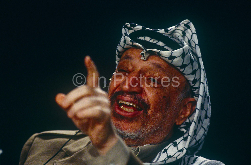 Palestinian leader Yasser Arafat speaks during an event in the summer of 1993 in London, UK. Mohammed Yasser Abdel Rahman Abdel Raouf Arafat al-Qudwa 1929 – 2004 was a Palestinian leader and Chairman of the Palestine Liberation Organization PLO, President of the Palestinian National Authority PNA and leader of the Fatah political party and former paramilitary group, which he founded in 1959.