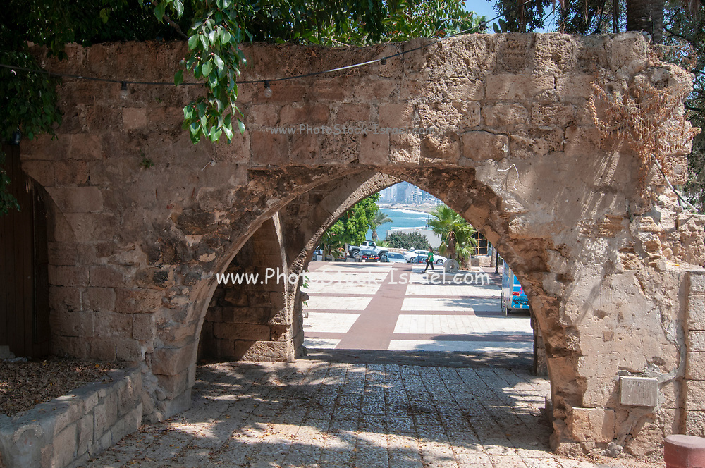 An ancient archway constructed with Kurkar a local, calcareous sandstone or fossilized sea sand dunes common in Israel. Photographed in the old Jaffa, Israel