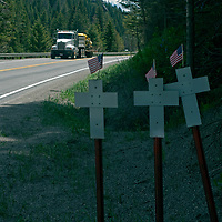 Crosses commemorate accident victims on U.S. Highway 191 through Gallatin Canyon, between Bozeman and Big Sky, Montana, one of nation's more dangerous roads.