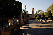 Plaza de Armas Morelia with a view in the background of Templo de los Agustinos, in the central highland city of Morelia, Michoacan state Mexico. The city is a UNESCO World Heritage Site and hosts on of the best preserved collection of Spanish Colonial architecture in the world.