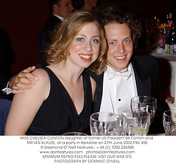 MISS CHELSEA CLINTON daughter of former US President Bill Clinton and MR IAN KLAUSE, at a party in Berkshire on 27th June 2002.PBK 492