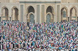 June 26, 2017 - Casablanca, Morocco - Moroccan Muslims gather to celebrate Eid al-Fitr Prayer in Casablanca's Hassan II mosque. Muslims around the world celebrate Eid al-Fitr marking the end of the fasting month of Ramadan in Casablanca, Morocco. (Credit Image: © Artur Widak/NurPhoto via ZUMA Press)