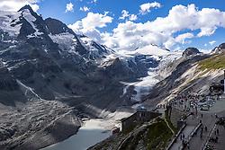 THEMENBILD - Die Pasterze ist mit etwas mehr als 8 km Länge der größte Gletscher Österreichs und der längste der Ostalpen. Seit 1856 hat ihre Fläche von damals über 30 km² um beinahe die Hälfte abgenommen. Hier im Bild Panoramaansicht der Pasterze mit Gletschersee, links der Grossglockner 3798m rechts Grossglockner Hochalpenstrasse mit Kaiser Franz Josefs Höhe. Heiligenblut, Österreich am Freitag 21. August 2020 // With a length of just over 8 km, the Pasterze is the largest glacier in Austria and the longest in the Eastern Alps. Since 1856, its area has decreased by almost half from then 30 km². Picture shows Panorama view of the Pasterze glacier with glacier lake, on the left the Grossglockner summit 3798m and on the right the Grossglockner High Alpine Road with Kaiser Franz Josefs Hoehe. Heiligenblut, Austria on Friday August 21, 2020. EXPA Pictures © 2020, PhotoCredit: EXPA/ Johann Groder