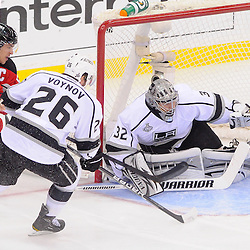 June 9, 2012: New Jersey Devils left wing Zach Parise (9) puts a pass through the crease in front of Los Angeles Kings goalie Jonathan Quick (32) during first period action in game 5 of the NHL Stanley Cup Final between the New Jersey Devils and the Los Angeles Kings at the Prudential Center in Newark, N.J.