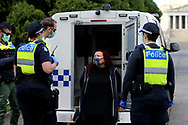 MELBOURNE, VIC - SEPTEMBER 05: A women is seen in the back of a police van after being arrested before the Anti-Lockdown Protest on September 05, 2020 in Sydney, Australia. Stage 4 restrictions are in place from 6pm on Sunday 2 August for metropolitan Melbourne. This includes a curfew from 8pm to 5am every evening. During this time people are only allowed to leave their house for work, and essential health, care or safety reasons. (Photo by Dave Hewison/Speed Media)