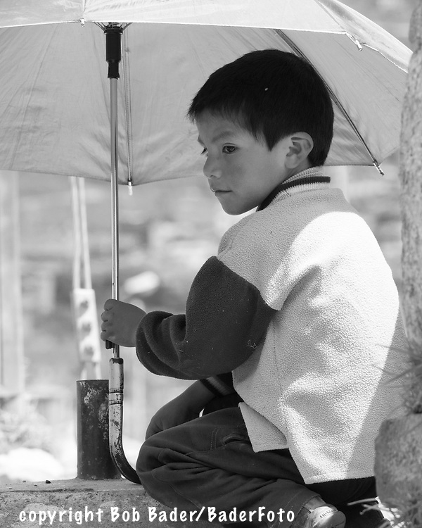 Boy sitting on wall