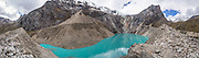 The turquoise waters of Jancarurish Lake are colored by glacial flour from Nevado Alpamayo (19,511 ft or 5947 m), in Alpamayo Valley, Cordillera Blanca, Andes Mountains, Peru, South America. Day 7 of 10 days trekking around Alpamayo, in Huascaran National Park (UNESCO World Heritage Site). This panorama was stitched from 8 overlapping photos.