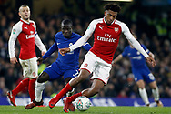 Alex Iwobi of Arsenal (R) in action with Ngolo Kante of Chelsea (L). Carabao Cup , semi final 1st leg match, Chelsea v Arsenal at Stamford Bridge in London on Wednesday 10th January 2018.<br /> pic by Steffan Bowen, Andrew Orchard sports photography.