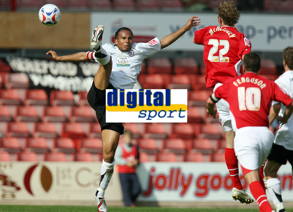 Photo: Rich Eaton.<br /> <br /> Wrexham v Hereford United. Coca Cola League 2. 24/09/2006. Tamika Mkandawire left of Hereford leaps high to foil John McAliskey