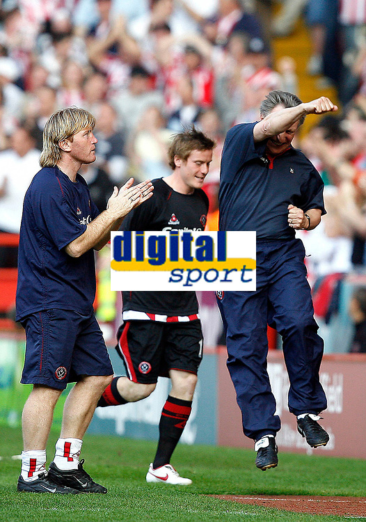 Photo: Paul Greenwood.<br />Sheffield United v West Ham United. The Barclays Premiership. 14/04/2007.<br />Sheffield United's Stuart McCall (L) applauds as manager Neill Warnock jumps for Joy