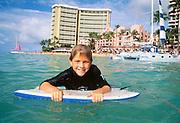 Boy on boogieboard, Waikiki, Oahu, Hawaii