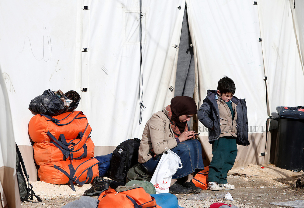 A migrant an her child rest outside a tent as refugees and migrants wait to continue their journey towards western Europe from the Macedonia-Serbia border at a transit camp in the village of Presevo, Serbia, February 2, 2016.<br /> Photo: Darrin Zammit Lupi