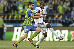 November 2, 2017 - Seattle, Washington, U.S - Soccer 2017: Whitecaps defender ALY GHAZAL (66) protects the ball against Seattle forward WILL BRUIN (17) as the Vancouver Whitecaps and Seattle Sounders play in the MLS Western Conference semi-final match at Century Link Field in Seattle, WA. Seattle won the match 2-0. (Credit Image: © Jeff Halstead via ZUMA Wire)