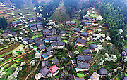 SANJIANG, May 12, 2016<br /> <br /> This photo taken with unmanned aerial vehicle on May 10, 2016 shows the Zhiliao Village in Dudong Township of Sanjiang Dong Autonomous County, south China's Guangxi Zhuang Autonomous Region. Sanjiang Dong Autonomous County, located in the north of Guangxi, is renowned in the world for its large numbers of drum towers, wind and rain bridges and traditional buildings of Dong ethnic group. <br /> ©Exclusivepix Media