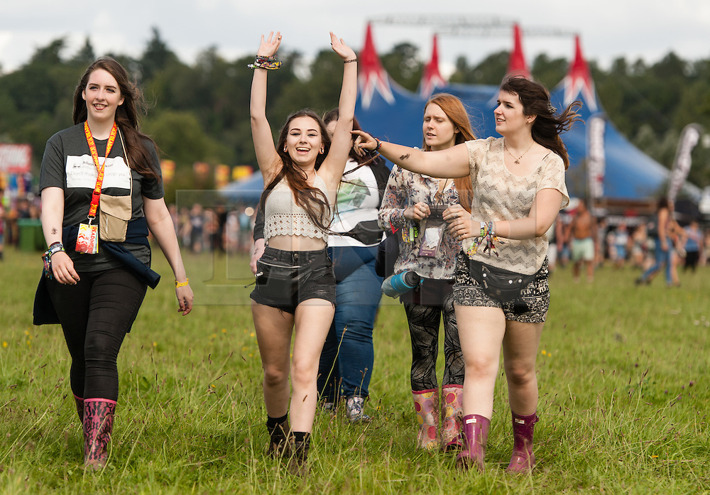 © Licensed to London News Pictures. 28/08/2015. Reading Festival, UK. Festival goers at Reading Festival on Day 1 of the festival walking through the music stage arena minutes after the gates opened for the first timePhoto credit: Richard Isaac/LNP