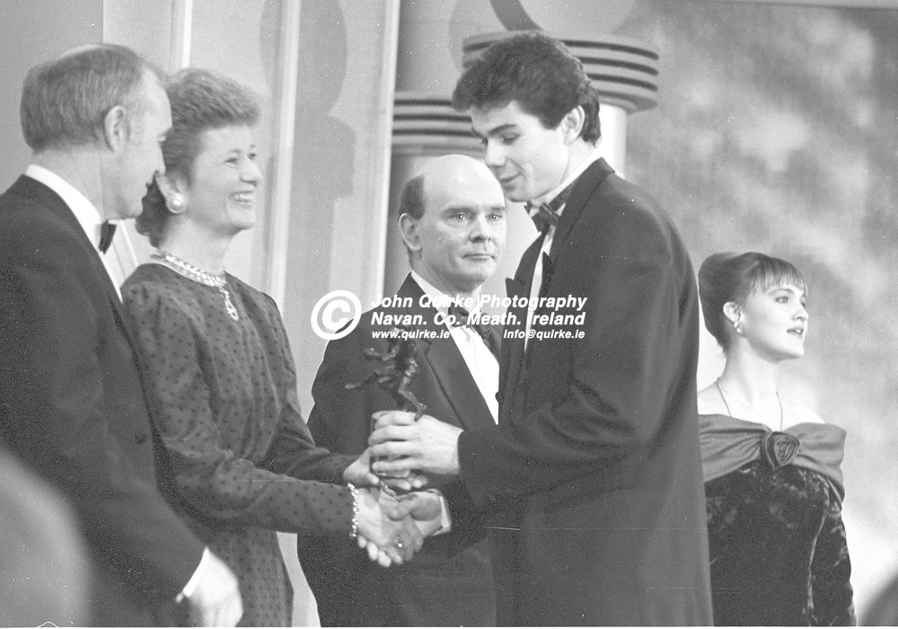 21-12-1991. 1991 Bank of Ireland GAA Football Allstars awards presentations at the Burlington Hotel, Dublin.<br /> President Mary Robinson pictured presenting a 1991 Football Allstars award to Keith Martin Lynch, Kildare.<br /> Photo: John Quirke / www.quirke.ie<br /> ©John Quirke Photography, 16 Proudstown Road, Navan. Co. Meath. (info@quirke.ie / 046-9028461 / 087-2579454).