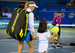 September 26, 2018 - Caroline Wozniacki of Denmark walks onto center court for her third-round match at the 2018 Dongfeng Motor Wuhan Open WTA Premier 5 tennis tournament (Credit Image: © AFP7 via ZUMA Wire)