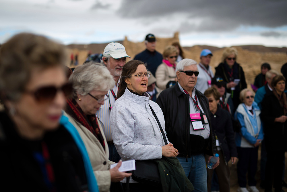 American Evangelical Christian tourists and pilgrims led by Former Arkansas governor Mike Huckabee (not pictured) are seen as they visit the ancient hilltop fortress of Masada in the Judean desert in Israel, on February 19, 2015, where they pray, sing together and learn about the importance of the site in Jewish History. The ancient ruined desert fortress on a wind-swept plateau overlooking the Dead Sea is seen by many as an emblem of Israel's fighting spirit, it is believed to be the place where close to a thousand Jewish rebels killed themselves and each other about two millennia ago, rather than surrender and fall into slavery under the Romans.