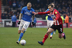 Marcus Maddison of Peterborough United in action with Harry Toffolo of Lincoln City - Mandatory by-line: Joe Dent/JMP - 01/01/2020 - FOOTBALL - Sincil Bank Stadium - Lincoln, England - Lincoln City v Peterborough United - Sky Bet League One