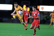 Mark Randall of Newport county (l) is challenged by Scott Wooton of MK Dons ®.EFL cup, 1st round match, Newport county v Milton Keynes Dons at Rodney Parade in Newport, South Wales on Tuesday 9th August 2016.<br /> pic by Andrew Orchard, Andrew Orchard sports photography.