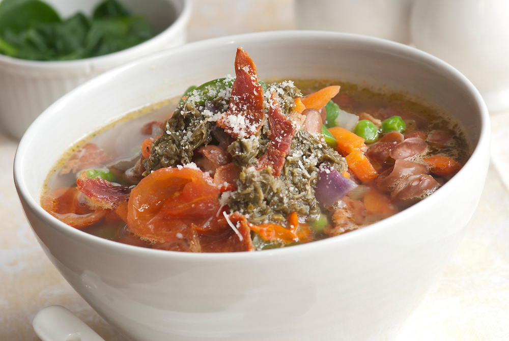 Italian bean and vegetable soup topped with crispy bacon and Parmesan