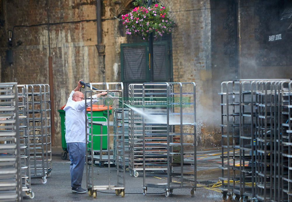 June 11, 2017 - London, LONDON, UK - LONDON, UK.  Bakers clean racks outside Bread Ahead in Borough Market. The market remain has remained closed since a terror attack a week ago killed eight people but is expected to begin reopening tomorrow (Monday) (Credit Image: © Cliff Hide/London News Pictures via ZUMA Wire)