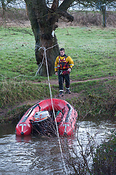 © Licensed to London News Pictures. 09/02/2014. Llangynidr,Wales, UK. Swansea Central Fire Service with an inflatable near the bridge at Crickhowell, Powys. A canoeist went missing today around midday on the River Usk. Photo credit : Graham M. Lawrence/LNP